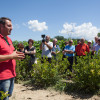 Visitors receive a tour of Greek Nurseries near Olympias