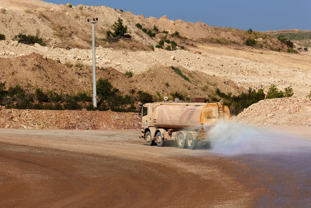 A water truck at a mine site helps to ensure clean air near our operations