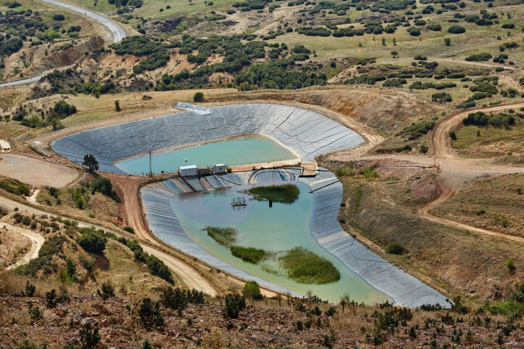 Rain water runoff from the waste rock areas and the open pit is collected in lined ponds.