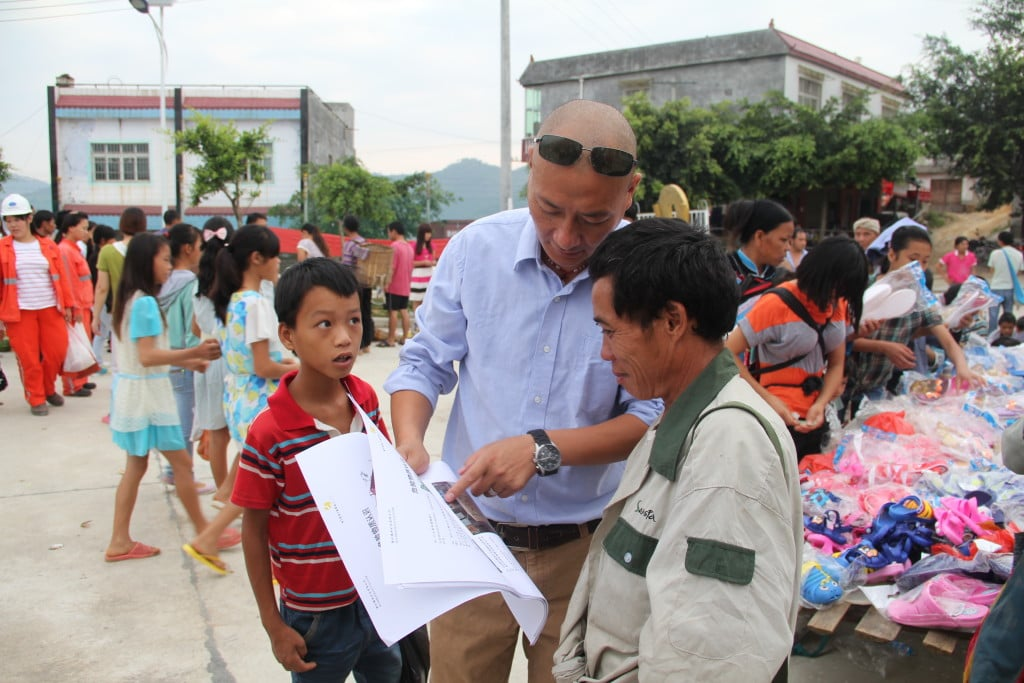 Our team member at Jinfeng talking to the local community about cyanide during the ICMC audit