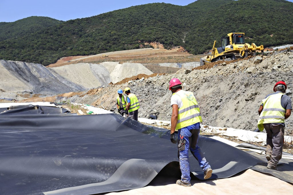 Laying liner for dry stack tailings at Kokkinolakkas, Greece.
