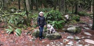 Teresa Conway hiking with dog, Toba.